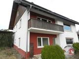 Gut geschnittenes Zweifamilienhaus mit  Garagen in Obersinn 698569